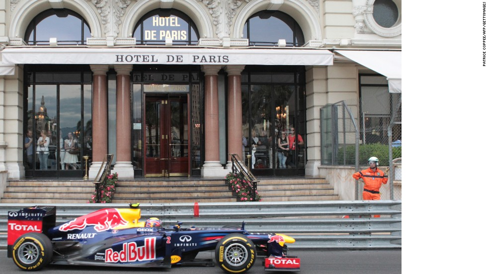 The racing drivers -- like Red Bull's 2012 winner Mark Webber shown here -- speed within inches of  Monte Carlo's famous landmarks.