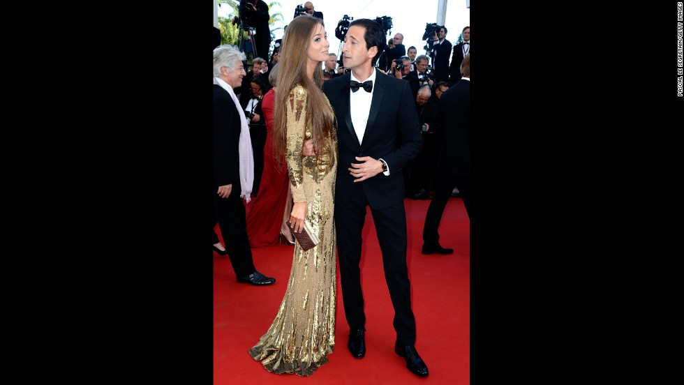 "Adrien Brody attends the Cannes premiere of ""Cleopatra"" on May 21 with Lara Nieto."