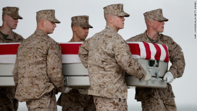 Marines just landed at Dover Air Force Base on May 7 carry the remains of one of seven troops killed in Afghanistan on May 4 .