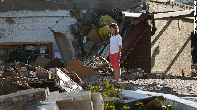 Image #: 22441831    epa03711006 A girl surveys the damage outside the Briarwood Elementary School in a destroyed neighborhood in Moore, Oklahoma, USA, 21 May 2013. The town was hit by a tornado on 20 May killing at least 24 people including seven children in one school.  EPA/TANNEN MAURY /LANDOV
