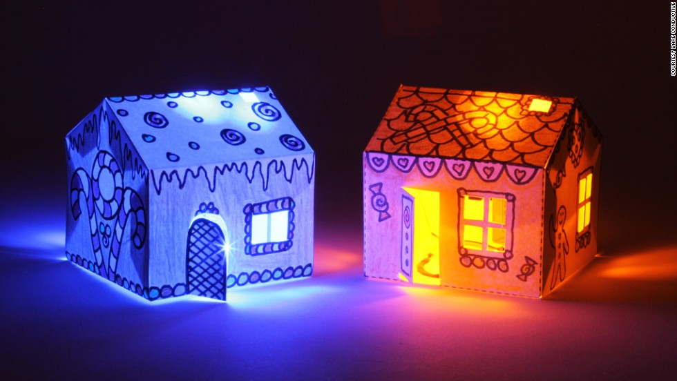 Bare Conductive's House Kit contains two paper houses, wired with conductive paint, which light up in the dark.