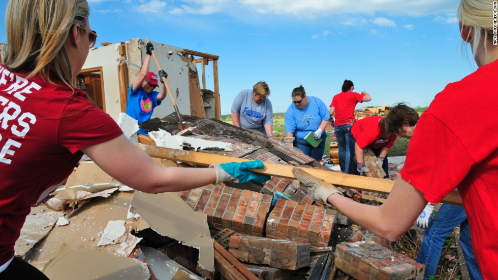 Teachers from Fairview Elementary School help clean up former school counselor Kay Taylor's home in south Oklahoma City on May 22, two days after an extremely powerful tornado tore through Moore, Oklahoma.
