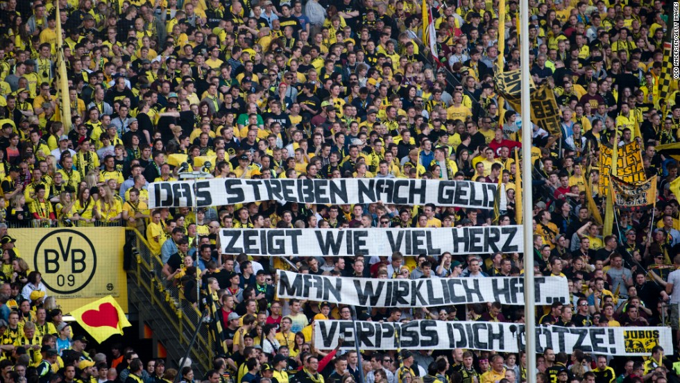 A banner reads 'The quest for cash reveals how much heart you really have, get lost Gotze' as Dortmund hosted Bayern Munich on May 4.
