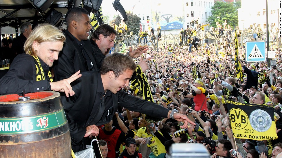 Gotze celebrates with colleagues and fans as Dortmund celebrate their 2012 league and cup double.