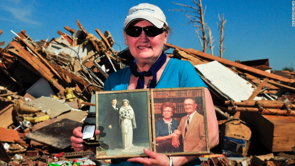 Carolyn Booher found her husband's wedding ring and several photos of her parents in the debris.