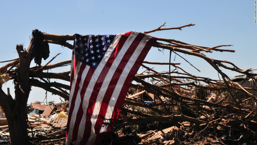 A flag hangs from a tree in a neighborhood in Moore that was in the direct path of the Oklahoma tornado.