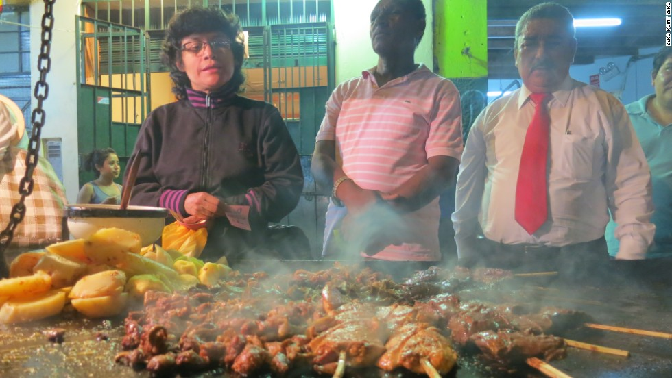 Chef Coque Ossio took Anthony Bourdain and Eric Ripert to one of his favorite street stalls in Lima for Anticuchos: grilled beef heart usually marinated in aji panca, cumin, vinegar, onions and oil.