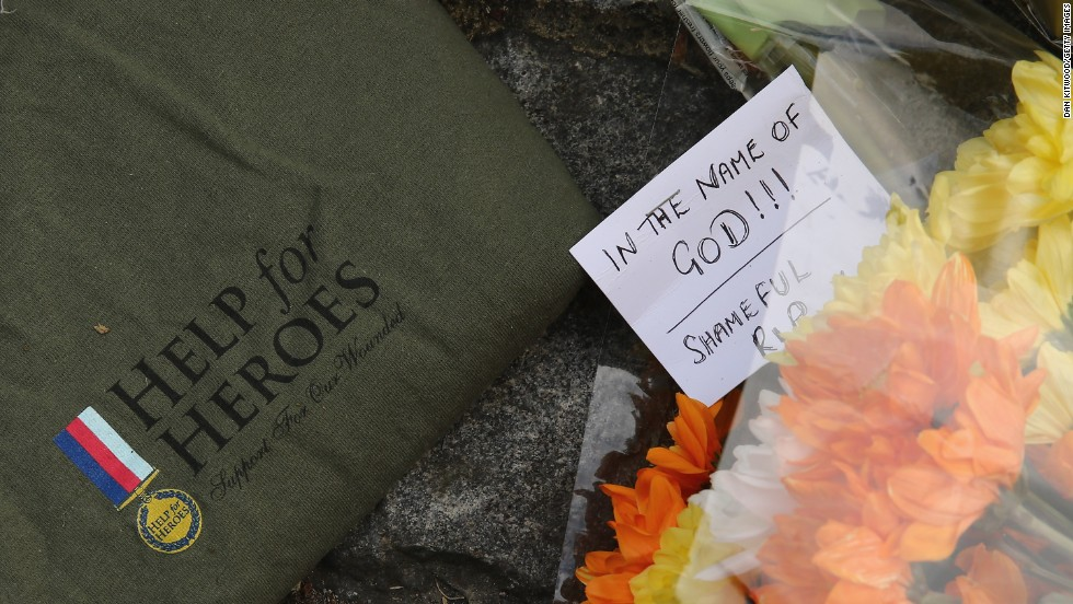 "Notes and shirts sit outside Woolwich Barracks on May 23. The slain soldier was wearing a ""Help for Heroes"" shirt when he was killed."
