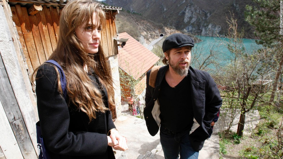 Jolie and Pitt visit refugees in the village of Medjedja, Bosnia, in April 2010.