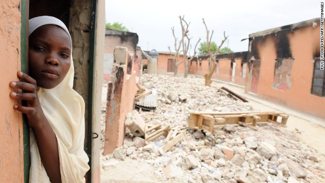 A female student stands in a classroom burnt by Boko Haram in Maiduguri, northeastern Nigeria, on May 12, 2012.