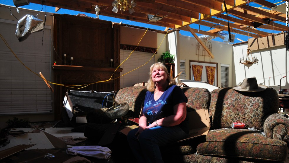 Frieda Stanley sits in what was once her living room. Her Oklahoma City neighborhood was hit by a deadly twister in May 1999 and again on Monday.