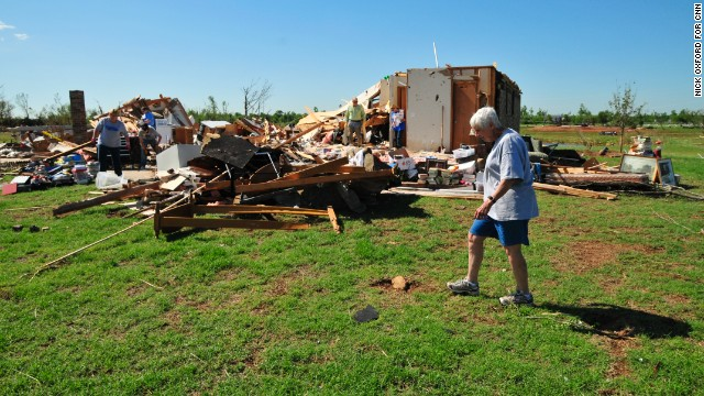 Kay Johnson, a retired elementary school counselor, looks over the remains home that was in the direct path of Mondays Tornado on Wednesday May, 22 in South Oklahoma City just west of Moore. The path that the tornado took through this neighborhood was almost exactly the same as on May 3rd 1999.  3120 sw 153rd st. Oklahoma City