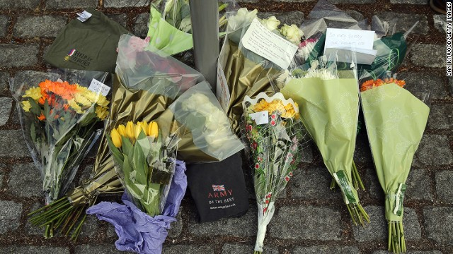 Flowers lay outside Woolwich Barracks on Thursday in London.