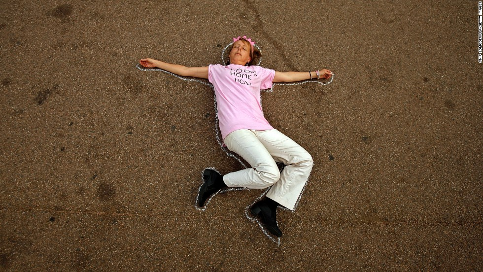 Benjamin demonstrates against George W. Bush's veto of the war appropriations bill by lying down in a chalk outline along Pennsylvania Avenue in front of the White House May 2, 2007.