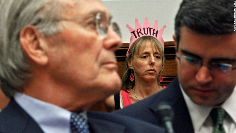 Benjamin sits in the back of a hearing room while former Secretary of Defense Donald Rumsfeld, left, testifies on August 1, 2007, before the House Oversight and Government Reform Committee about the combat death of NFL star and Army Ranger Pat Tillman.