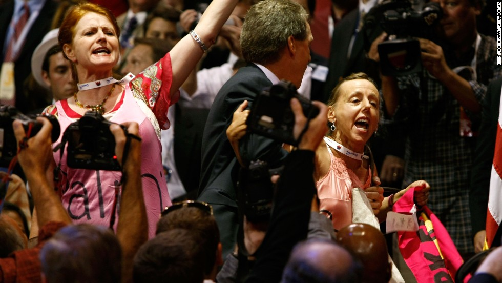 Benjamin and another protester are escorted out of the Republican National Convention on September 3, 2008, in St. Paul, Minnesota.