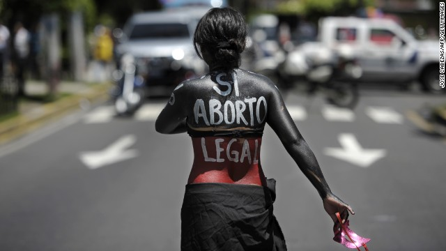 (File) A woman marches on the International Day of Action for the Decriminalization of Abortion in San Salvador.