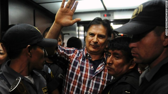 Former Guatemalan President Alfonso Portillo waves upon arrival in court in Guatemala City on January 31, 2013.