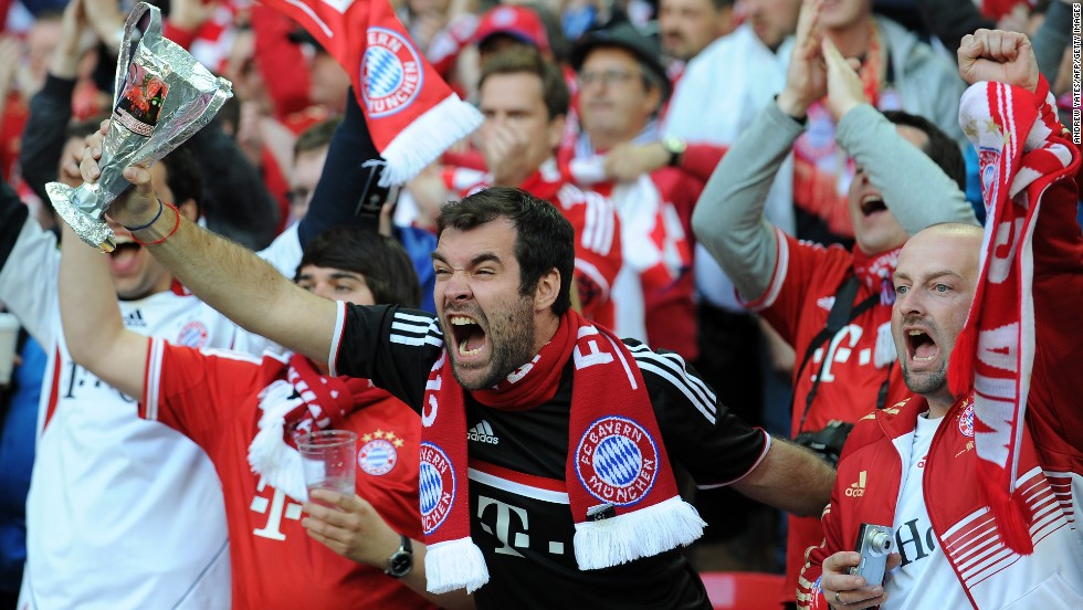 Bayern Munich supporters cheer from the stands.