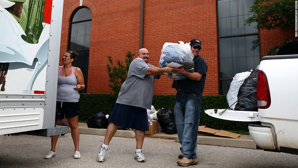 Volunteers unload donated items for tornado victims at the Yellow Rose Theater on May 25 in Moore.