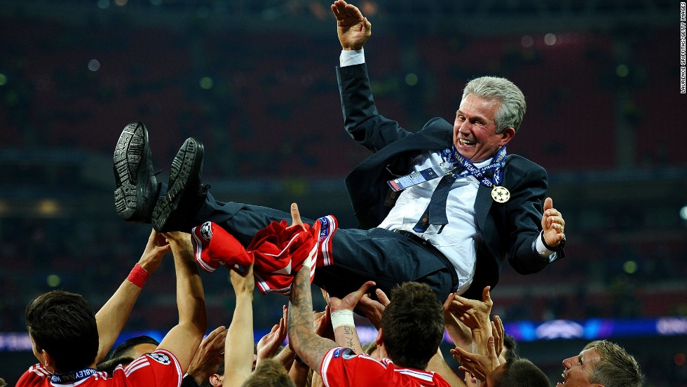 Bayern Head Coach Jupp Heynckes is carried by his players after winning the UEFA Champions League final.