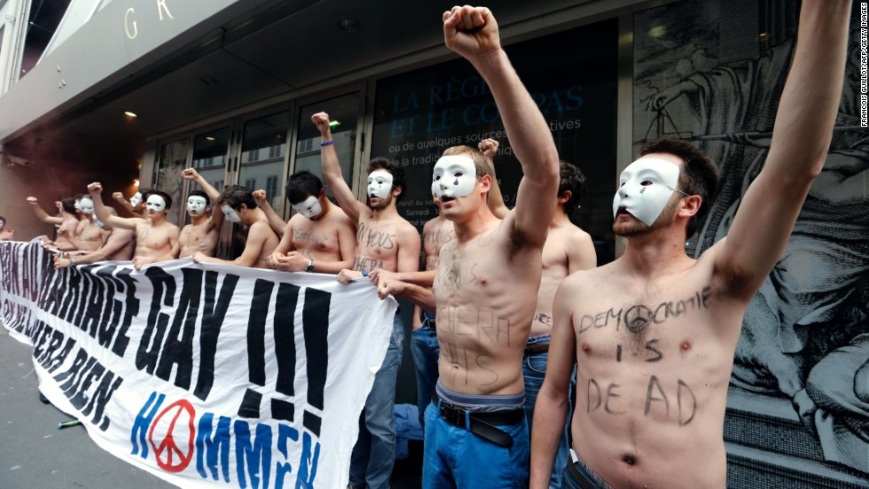 Opponents of the law  demonstrate in front of the headquarters of the Grand Orient de France, a Masonic order, in Paris on Friday, May 24.