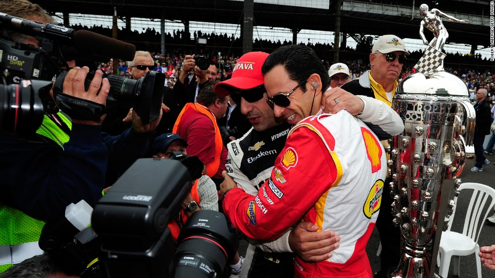 Tony Kanaan, left, and Hélio Castroneves of Brazil greet each other.