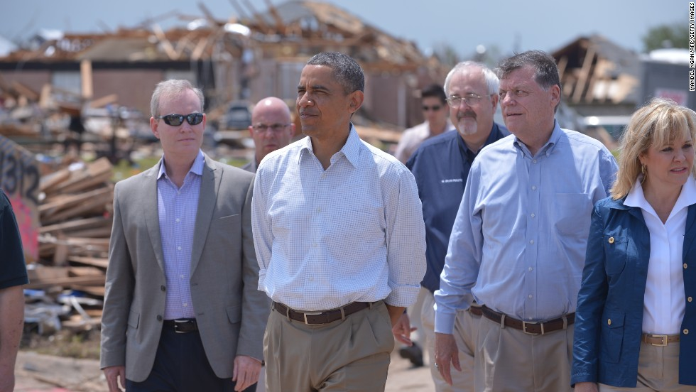 Obama tours a tornado-affected area in Moore, Oklahoma, in May 2013. A tornado that ripped through Moore hit 2,400 homes on a 17-mile path.