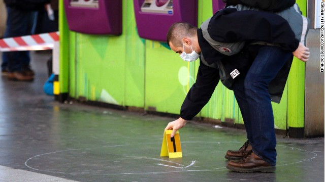 A police investigator works at the site where a man attacked a French soldier patrolling a subway station in Paris.