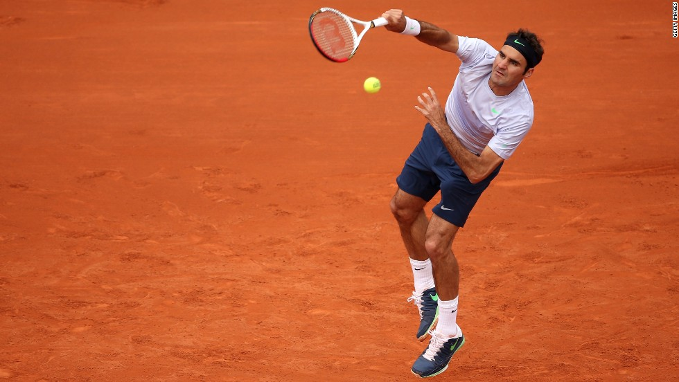 Roger Federer of Switzerland serves against Pablo Carreno-Busta of Spain on May 26. Federer beat Correno-Busta 6-2, 6-2, 6-3.