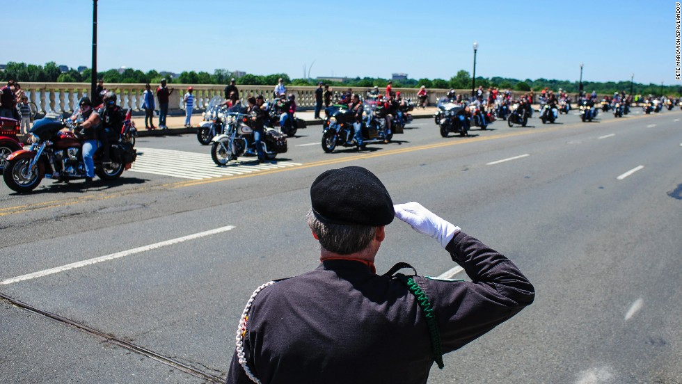 "Jim Cloyes salutes riders taking part in Rolling Thunder's ""Ride to the Wall"" on May 26 in Washington. Every Memorial Day weekend thousands of motorcyclists gather in the nation's capital and make their way to the Vietnam Veterans Memorial."
