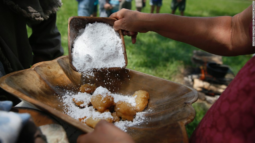 Patricia Corral makes calas, deep-fried rice cakes that were a popular breakfast dish in New Orleans dating back to the 1800s, during the living history event May 26 in Chalmette.