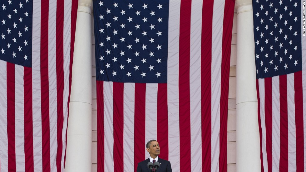 "Obama delivers <a href=""http://www.cnn.com/2013/05/27/politics/obama-arlington-speech-wreath/index.html"">Memorial Day remarks</a> at Arlington National Cemetery on May 27. ""This time next year, we will mark the final Memorial Day of our war in Afghanistan,"" he said."