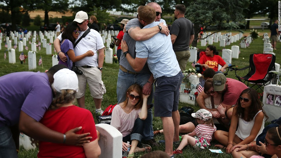 "Friends and family gather at Arlington National Cemetery on May 27 to visit the grave site of <a href=""http://www.cnn.com/SPECIALS/war.casualties/memorial.html?campaignID=EF&soldierID=91c5b3eb1cf37bf0cb7afb732fdcbb9b&initialHometown=Wayne,%20PA"">Army Capt. Ronald George Luce Jr</a>. He died in a roadside bombing in Afghanistan in 2009."