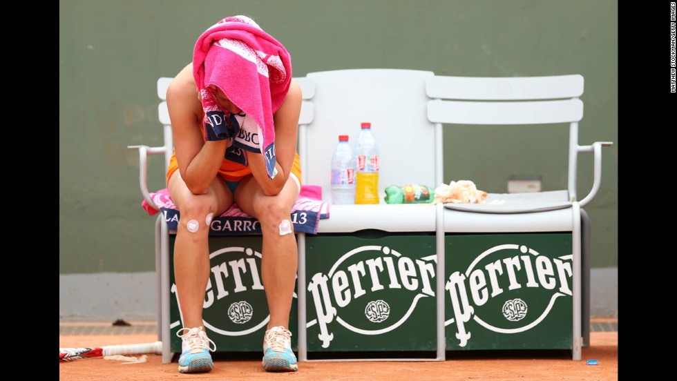 Barbora Zahlavova Strycova of Czech Republic covers her face during a break in the match against Bojana Jovanovski of Serbia on May 27. Strycova lost to Jovanovski 6-3, 6-2.