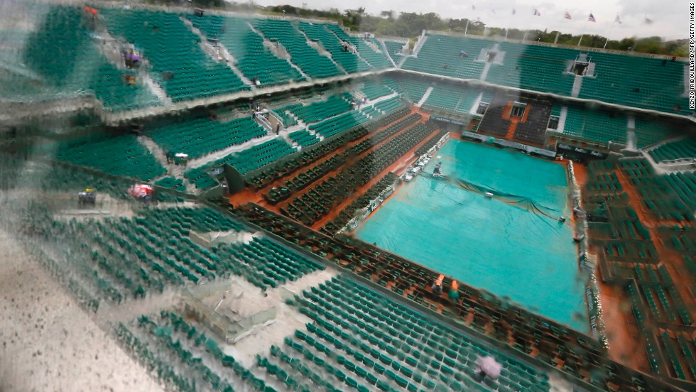 Rain causes delays on the third day of the French Open in Paris, on May 28, as a covering tries to keep the Philippe Chatrier central court at Roland Garros stadium dry.