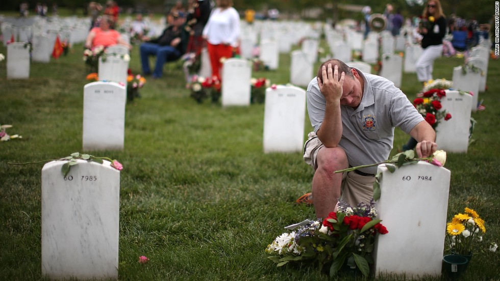 "MAY 28 - ARLINGTON, U.S.: <a href=""http://cnn.com/2013/05/27/politics/obama-arlington-speech-wreath/index.html"">Observing Memorial Day</a>, Alex Burgess visits the Arlington Cemetery gravesite of an old friend who was killed in Iraq. More than <a href=""http://edition.cnn.com/SPECIALS/war.casualties/index.html"">8,100 coalition troops from at least 36 countries have died</a> and more than 50,000 have been wounded in Iraq and Afghanistan since 2001."