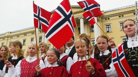 OSLO, NORWAY - APRIL 17: Unidentified Norwegian teenagers hold flags during the christening of Princess Ingrid Alexandra - daughter of Crown Prince Haakon and Crown Princess Mette-Marit outside The Royal Palace on April 17, 2004 in Oslo, Norway. The Princess was born on January 21, 2004 and is second in line to the throne. (Photo by Pascal Le Segretain/Getty Images)