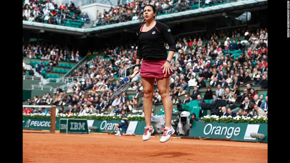 France's Marion Bartoli warms up during her match against Belarus' Olga Govortsova on May 28.