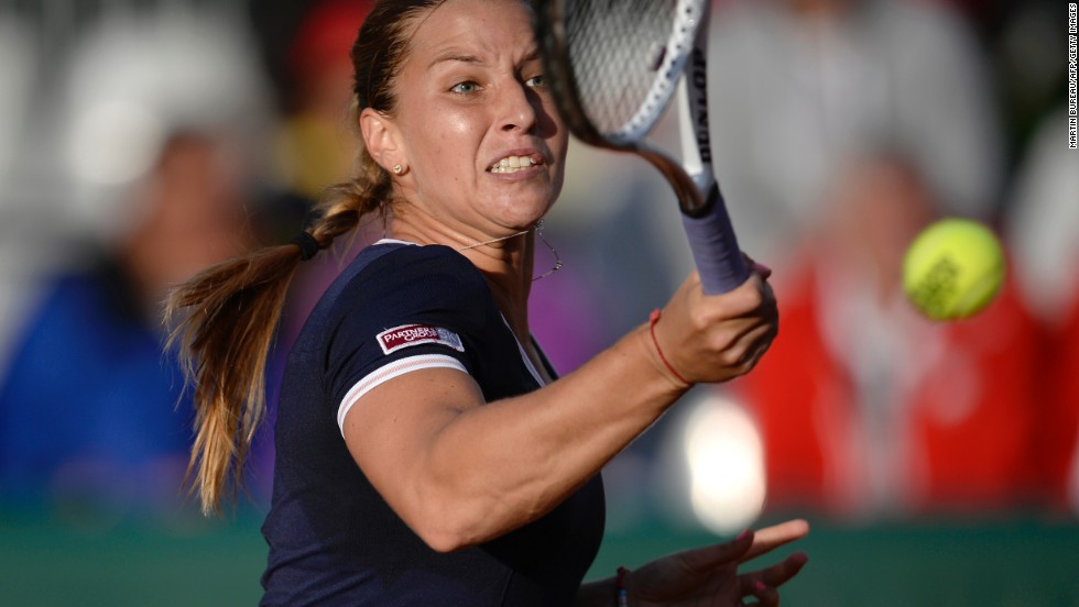 Slovakia's Dominika Cibulkova hits a forehand shot to Ukraine's Lesia Tsurenko during the first round match on May 28. Cibulkova won 6-1, 6-4.
