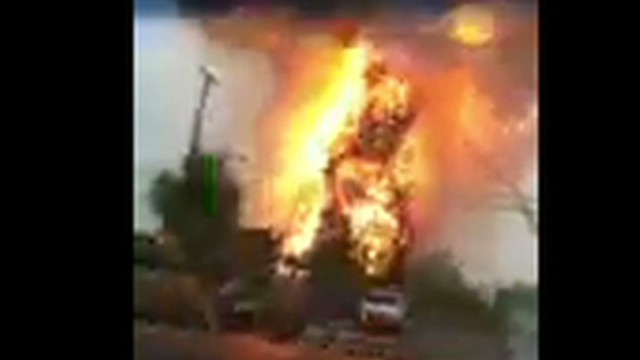 Explosion surprises man filming fire