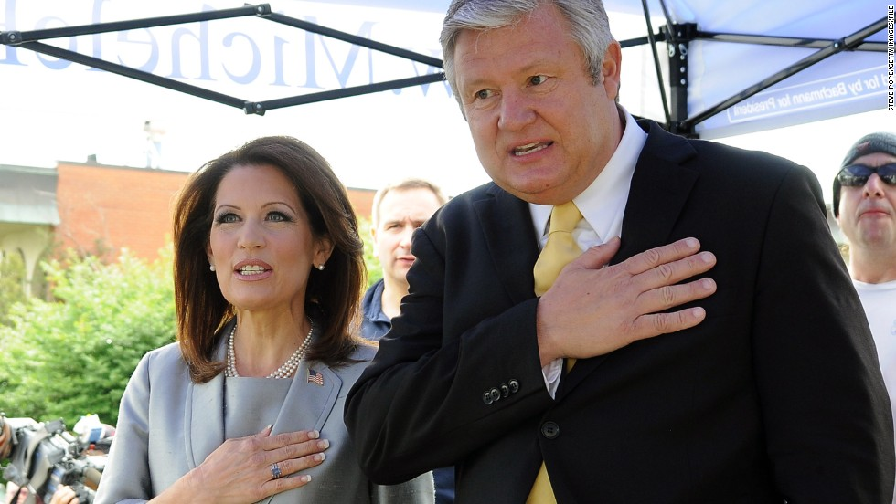 Bachmann and her husband, Marcus, recite the Pledge of Allegiance before she announced her candidacy for the 2012 Republican presidential nomination in Waterloo, Iowa, in June 2011. The congresswoman was born in Iowa.