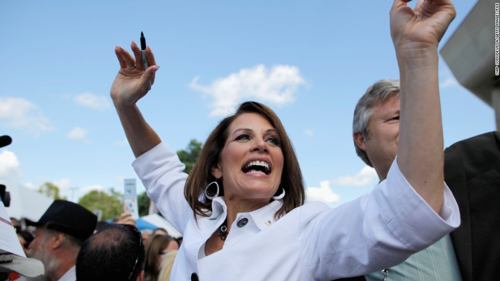 Bachmann encourages people to vote for her in an August 2011 appearance outside the Hilton Coliseum at Iowa State University in Ames, Iowa. Her presidential campaign reached its peak that month when she beat out a slate of other candidates to win the Ames Straw Poll in Iowa.