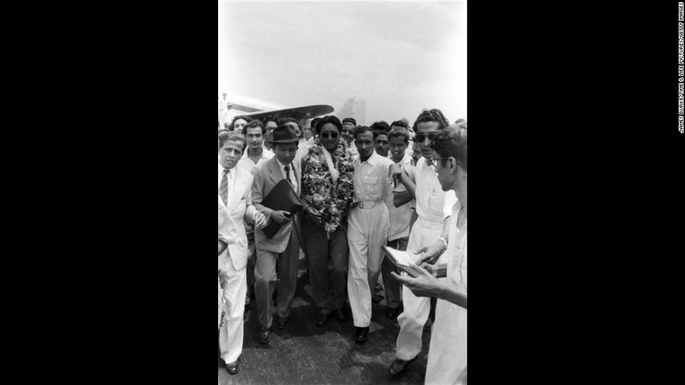 Tenzing arrives in India after his ascent.