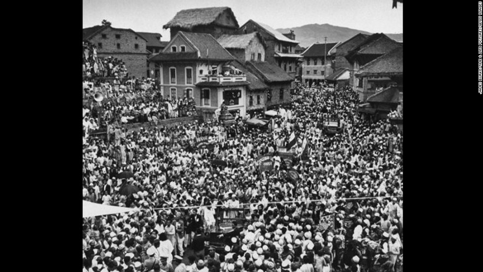 Tenzing, Hunt and Hillary are welcomed in Bhandgaon, Nepal.