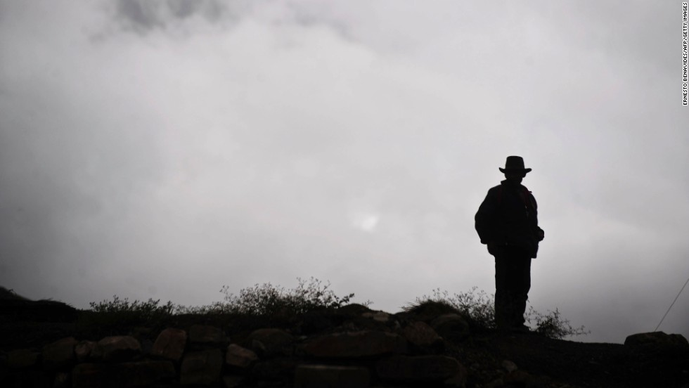 A man stands on a hill at the ancient Chavin archaeological site in Peru in October 2011.