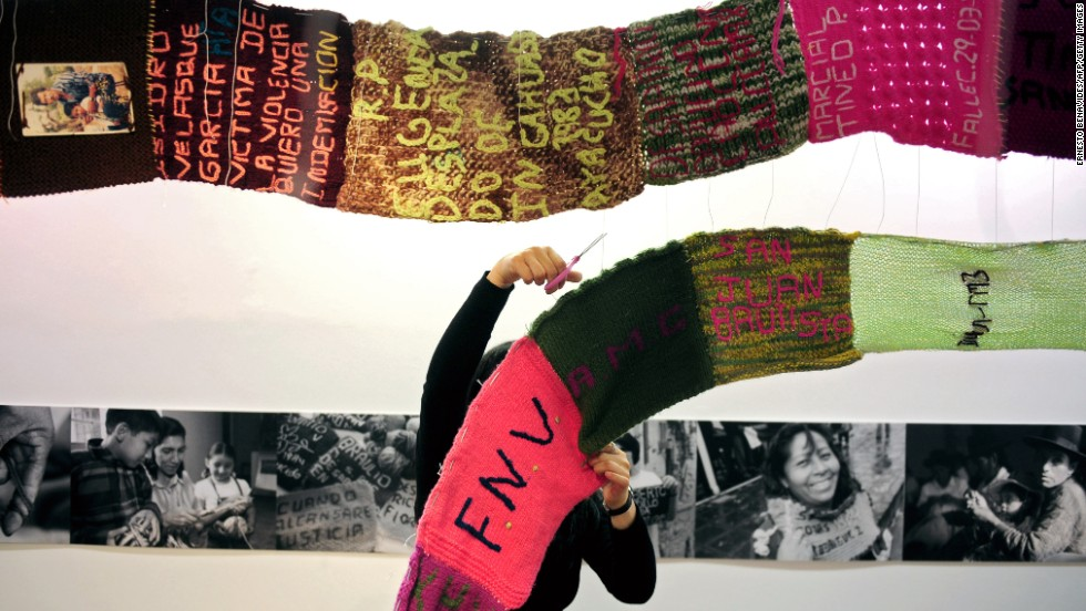 "An organizer takes down the ""Scarf of Hope"" exhibit in Lima on November 29, 2010. The scarf was made by victims of political violence in Peru."