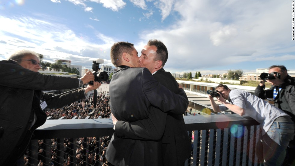 "MAY 30 - MONTPELLIER, FRANCE: Vincent Autin and Bruno Boileau kiss in front of a crowd of supporters after their wedding, <a href=""http://cnn.com/2013/05/29/world/europe/france-same-sex-wedding/index.html"">France's first official gay marriage</a>. While France has allowed civil partnerships for some years, controversial legislation allowing same-sex couples to wed and adopt was <a href="".cnn.com/2013/05/18/world/europe/france-same-sex-marriage/index.html"">signed into law 10 days ago</a>."