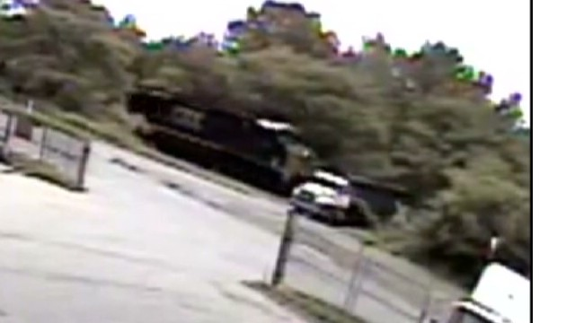 See freight train demolish truck