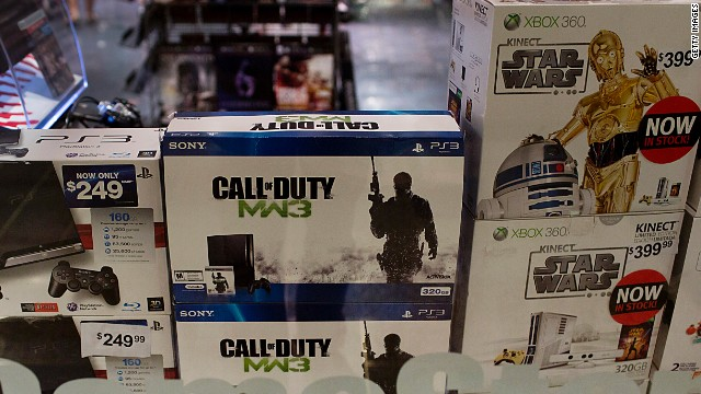 Sony's PlayStation 3 and Microsoft's Xbox are displayed at a GameStop store in New York. Both will get updates this year.